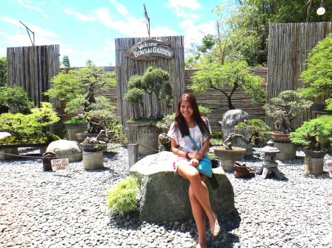 At hidden Garden. Pretty bonsai tress at my back.